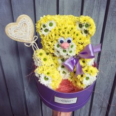 Teddy bear made from yellow chrysanthemums