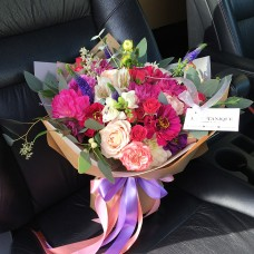 Bouquet with purple veronica, pink zinnia and chrysanthemum