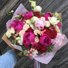 Dark red roses bouquet with peonies