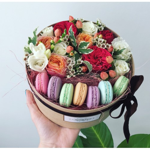 Tea box with cookies macaroon, roses and apple flowers