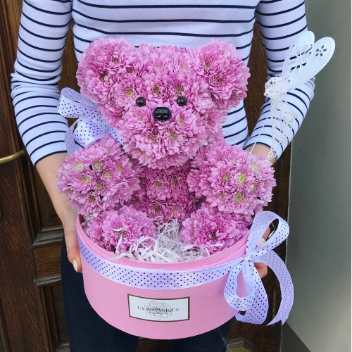 Teddy bear made from chrysanthemums in a gift box