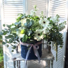Box with gerberas and eucalyptus