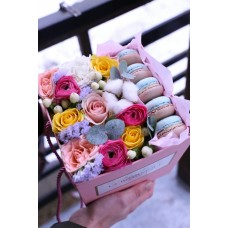 Box with macaroon biscuits, rose ranunculus and cotton