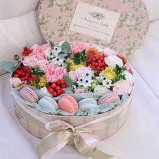 Box with roses, berries and macaroon cookies