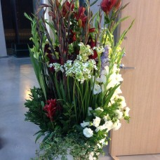 Floor decoration with delphinium and amaryllis for the hall design