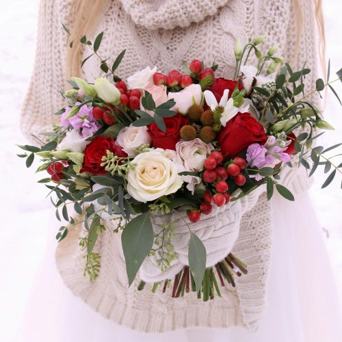Brides bouquet with red roses, eustoma and eucalyptus