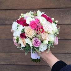 Fuchsia colored roses bouquet with ranunculus