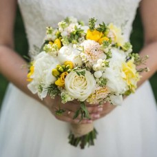 Bouquet with yellow freesia and white peonies